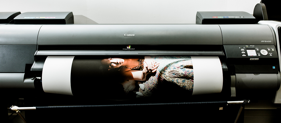 print of woman coming out of canon inkjet printer